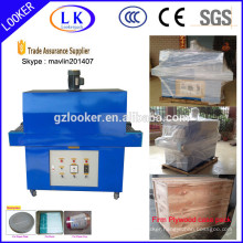 Shrink film wrapping machine
