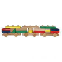 Blocs de construction assemblant des jouets en train en bois