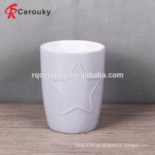 Caneca de leite de cerâmica em relevo em forma de estrela sem alça