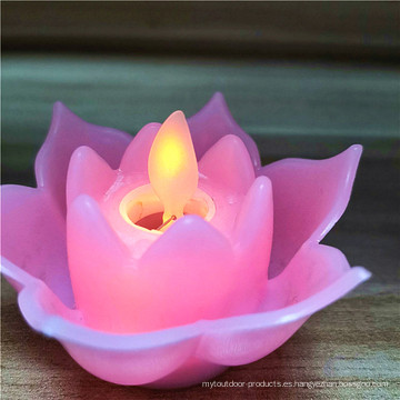 Flor bailando llama a pilas con velas