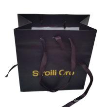 Бумажный мешок с фиолетовым орнаментом, ленты
