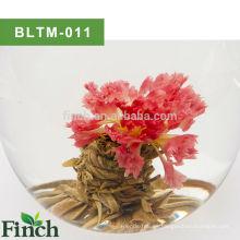 Té chino del arte Calendula rosada Flor floreciente Bola de té verde