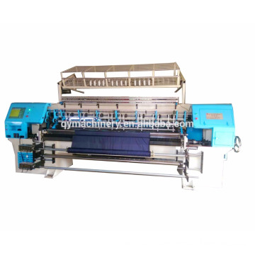 Computerized multi-needle shuttle less quilting mattress machine