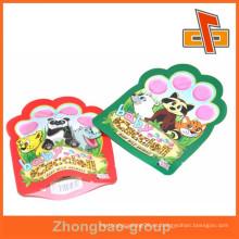 Acepte el bolso de plástico de la forma de encargo suave del OEM para la comida de animal doméstico o el embalaje diario del producto con la muesca del rasgón