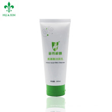 Plastic laminated cosmetic skin cleanser tube with flip top cap