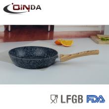 uso de sartén de revestimiento de granito en cocina de inducción