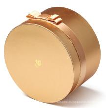 Caja de papel redonda cosmética de oro metálico