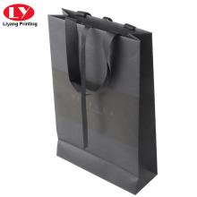 Black branded logo paper bag with ribbon