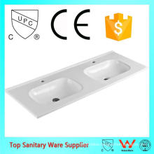 foshan cheap commercial mounting above cabinet bathroom basin