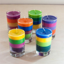 scented glass jar candle with layered color wax