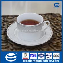 Vasos de cerámica de té de China, taza de té de porcelana decorada oro y platillo