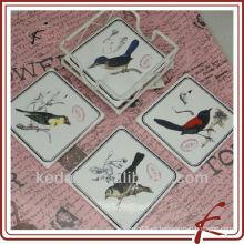 Diseño de aves y posavasos de cerámica con hierro