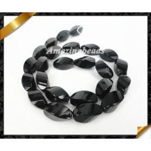 Natürliche schwarze Onyx facettierte verdrehte Reisform Edelsteinperle (AG018)