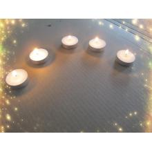 White pressed paraffin wax tealight candle
