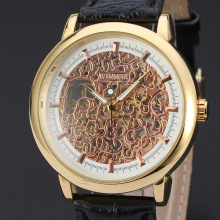 elegant rose golden skeleton watch with leather band