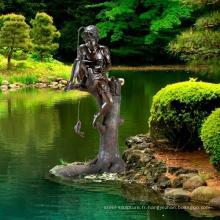 extérieur jardin décoration métal artisanat brozne garçon pêche fontaine