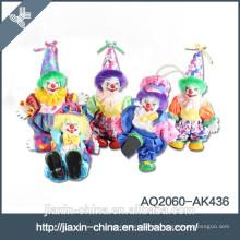 Lustig fertigen Sie Farbfeiertagsgeschenkporzellan-Clownpuppenspielwaren besonders an