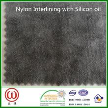 O nylon de carvão vegetal da colagem da melhor qualidade que entrelinha com óleo de silicone para o PVC macio