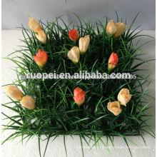 tapete / esteira falsificados baratos naturais novos da grama verde com a flor para a decoração do jardim