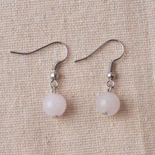 Boucles d'oreilles en argent avec quartz rose et pierres précieuses