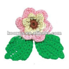Crocheted flower embellishment for garment