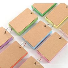 Umweltfreundliches Spiralnotizbuch mit farbigem Papier