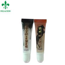 pequeño tubo de brillo de labios vacío con boca oblicua