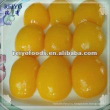 Консервированные половинки персика в легком сиропе