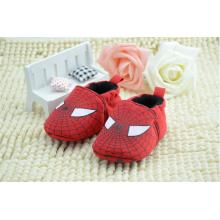 Los zapatos de bebé lindos del algodón venden al por mayor el moccasin del bebé calzan los zapatos de bebé de los zapatos del niño