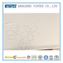Tela de poliéster de algodón transpirable barato para colchón