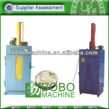 Hydraulic waste barrel baler