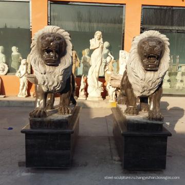 черные мраморные статуи Львов