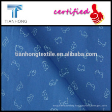 light weight blue background glasses design printed on poplin weave cotton fabric for shirt
