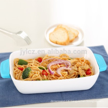 white ceramic bakeware with heat-resistant silicone handles