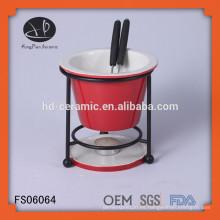 Caliente venta de fondue de chocolate de porcelana con horquillas y soporte de hierro, redonda mini fondue de porcelana con estantería