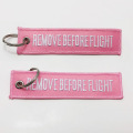 Double sided remove before flight tag embroidered keychain