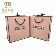 Preiswertes handgemachtes kleines hellrosa lamelliertes Einkaufen tragen Papiergeschenk-Taschen mit kundenspezifischem Logo