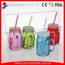 Venta al por mayor Conjunto de 4 vasos de vidrio transparente Mason jarras tazas con tapa y cesta de metal