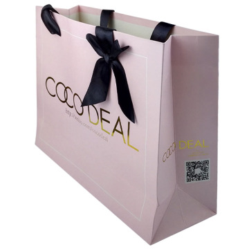 art paper bag with gold logo and ribbon