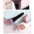 Escova bonito preta cor-de-rosa da fundação da pata do gato