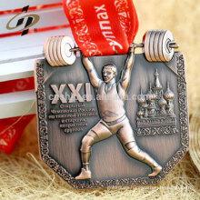 Medalla deportiva de metal de oro de levantamiento de pesas personalizada con cinta