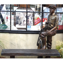 outdoor life size bronze sculpture of a caddy with a bench