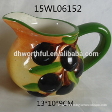 2016 hot sale ceramic milk jug with olive figurine
