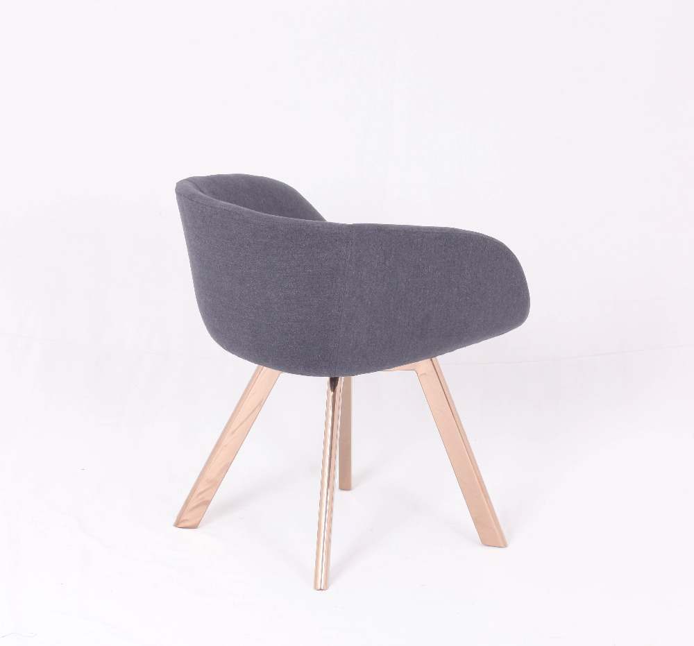 Gold leg Tom Dixon dining chair