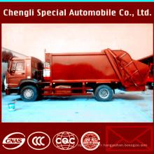 Camion de recyclage de compacteur de déchets de 6Wheels 4X2 LHD HOWO