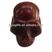 Naturstein geschnitzter Schädel Roter Jaspis