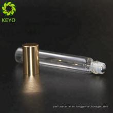 Las botellas de cristal de oro esmerilan el rollo de cristal en los envases 5ml de cristal fino ruedan en la botella alrededor de 8 ml de la botella del tubo para el perfume