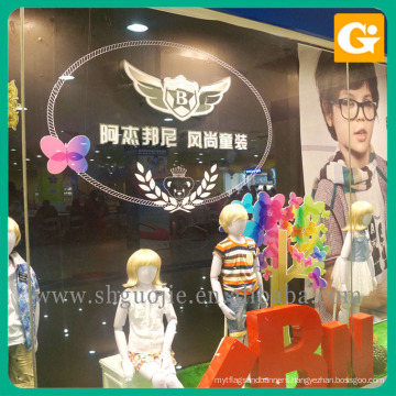Children's clothing shop window poster advertising