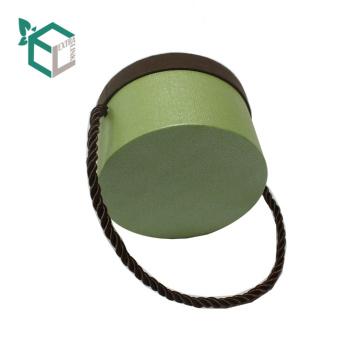 Guangzhou-Lieferanten-kundenspezifische Perlen-Pappkreis-Kreis-Form-Blumen-Verpackenkästen mit Schnur-Griff