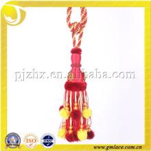 Lazo rojo de la borla del oro de la mezcla con la bola del pompom